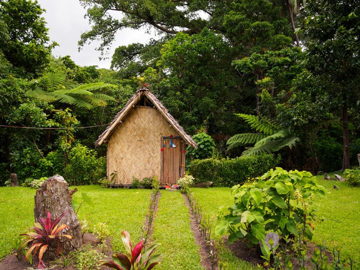 A traditionalthatched bungalow in a local village.