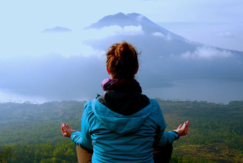 Taking in a moment of reflection after hiking an active volcano to see the sunrise in Bali, Indonesia