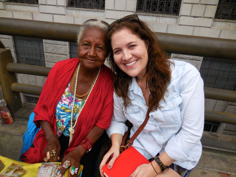 Asking the Big Shared World questions of a tarot card reader in downtown Brazil, who also answered her three questions. Fortu