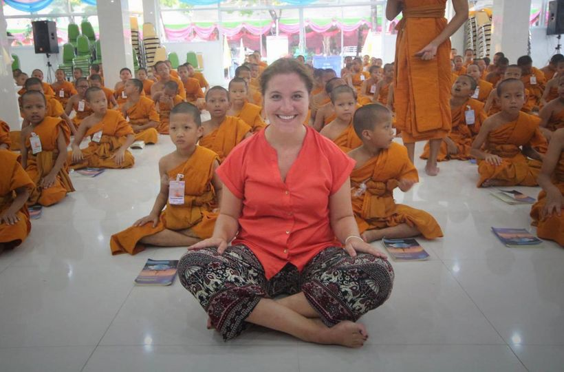 Sitting with a group of young Buddhists in Bangkok, Thailand. While spending the day with a local tour guide, we biked throug