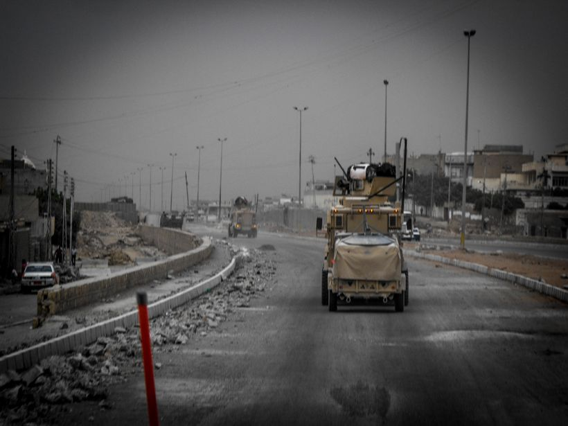 A US convoy rolling through the streets of Mosul in 2008