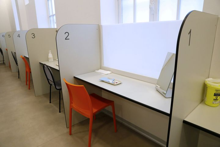 A room with cubicles with trays of injection materials is seen at the SCMR (Drug supervised injection site).