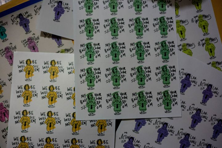 Stickers for the protest created by Isabel Kim, Syra Ortiz-Blanes, and Amanda Silberling.