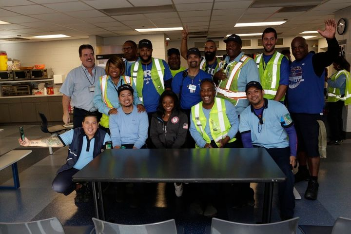 Simone meets with United crew members behind the scenes at O'Hare International Airport.