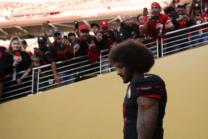 Colin Kaepernick walks on the field prior to an NFL game against the Arizona Cardinals at Levi's Stadium on October 6, 2