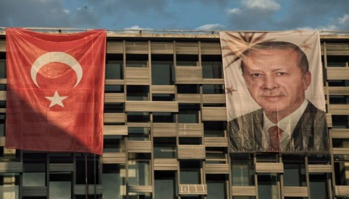 President Recep Tayyip Erdogan's poster hangs over a cultural center in Istanbul's Taksim Square.