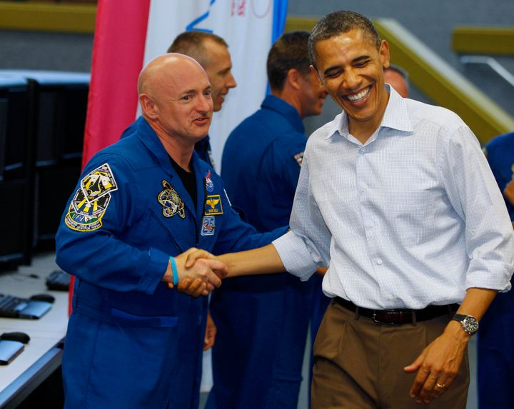 U.S. President Barack Obama shakes hands with space shuttle Endeavour mission commander Mark Kelly (R) after the mission was