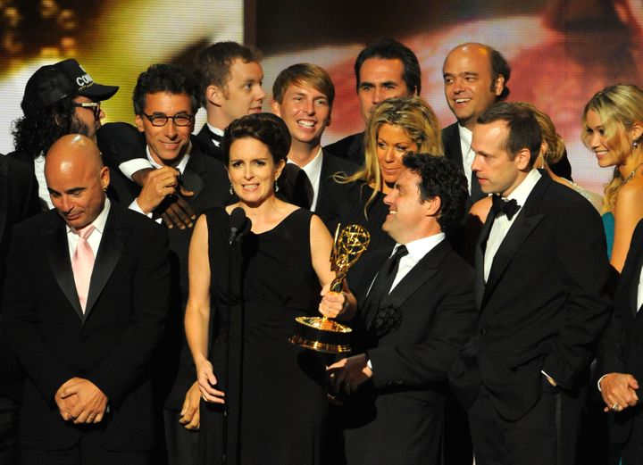 "Tina Fey and the cast of ""30 Rock"" accepting the Emmy award for Outstanding Comedy Series in 2009. The series won a total of"