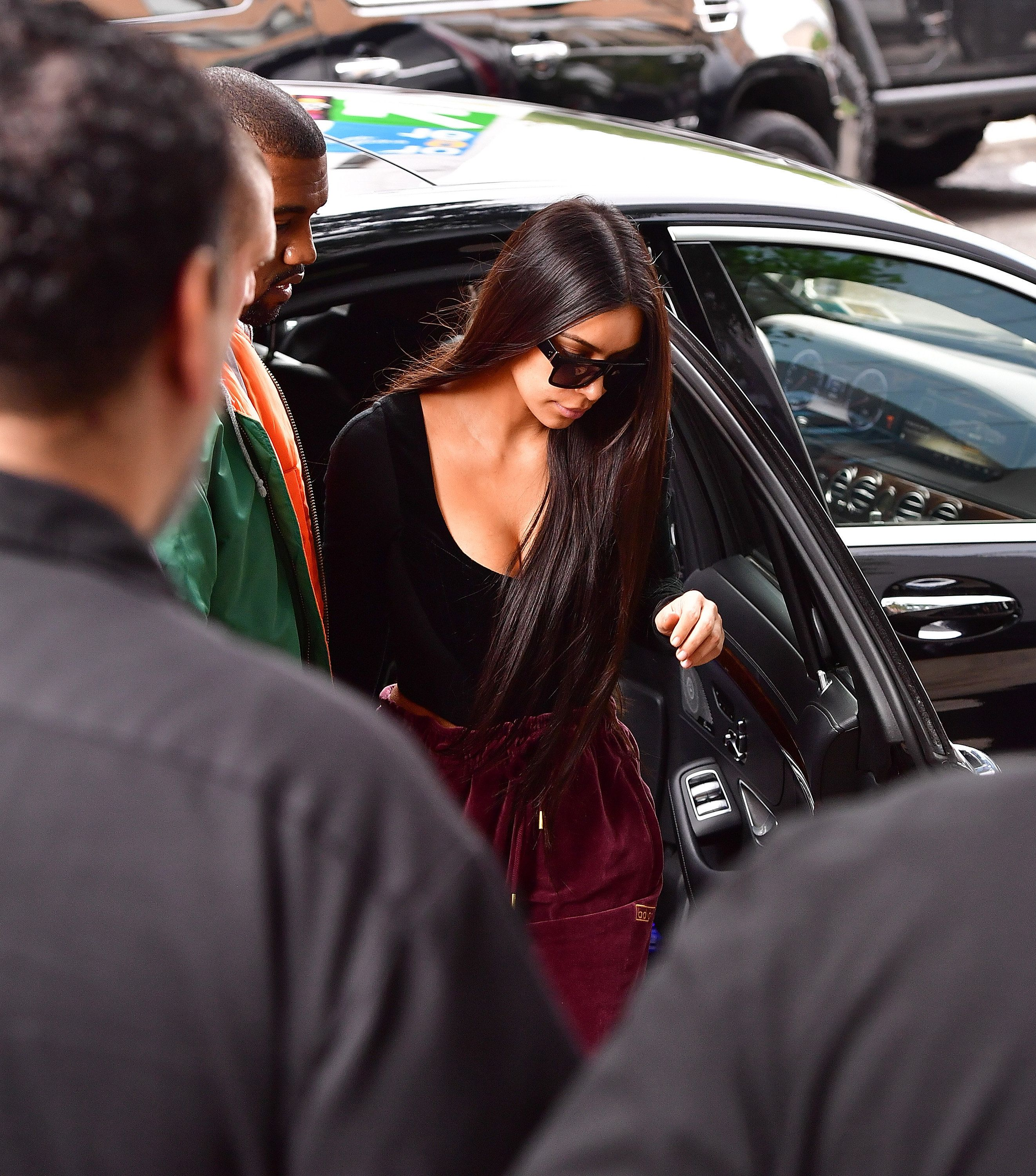Kanye West and Kim Kardashian arrive at their Manhattan apartment on Oct. 3.