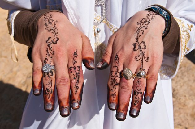 Recently married Hergueme Takwa shows off her hennaed hands in Tozeur,