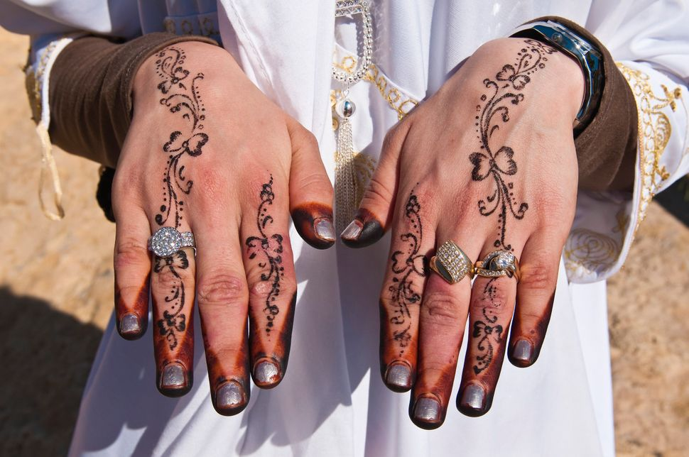 Recently married Hergueme Takwa shows off her hennaed hands in Tozeur, Tunisia.