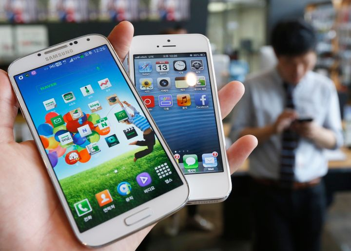 Samsung Electronics' Galaxy S4, left, with Apple's iPhone 5.