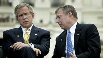 """U.S. Attorney General John Ashcroft (R) talks with U.S. President George W. Bush during ceremonies at the 22nd annual National Peace Officers' Memorial Service, at the Capitol in Washington, in this May 15, 2003 file photo. Ashcroft and Commerce Secretary Donald Evans resigned in a post-election shake-up of President George W. Bush's Cabinet, the White House announced on November 9, 2004. """"The president accepted their resignations,"""" White House spokesman Scott McClellan said. REUTERS/Jason Reed  JIR/MR"""