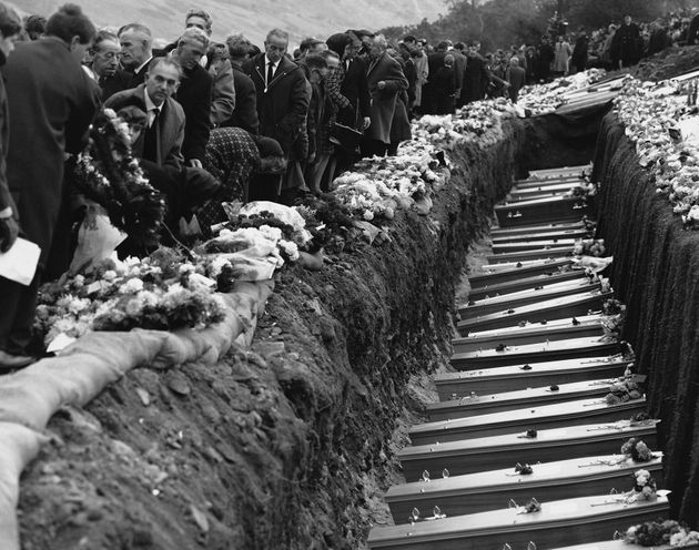 Mourners at the graves of the 144 victims of the