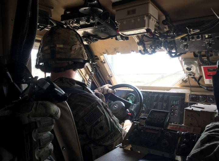 U.S. troops drive through Qayyarah Airfield West in a Mine Resistant Ambush Protected vehicle on Oct. 7.
