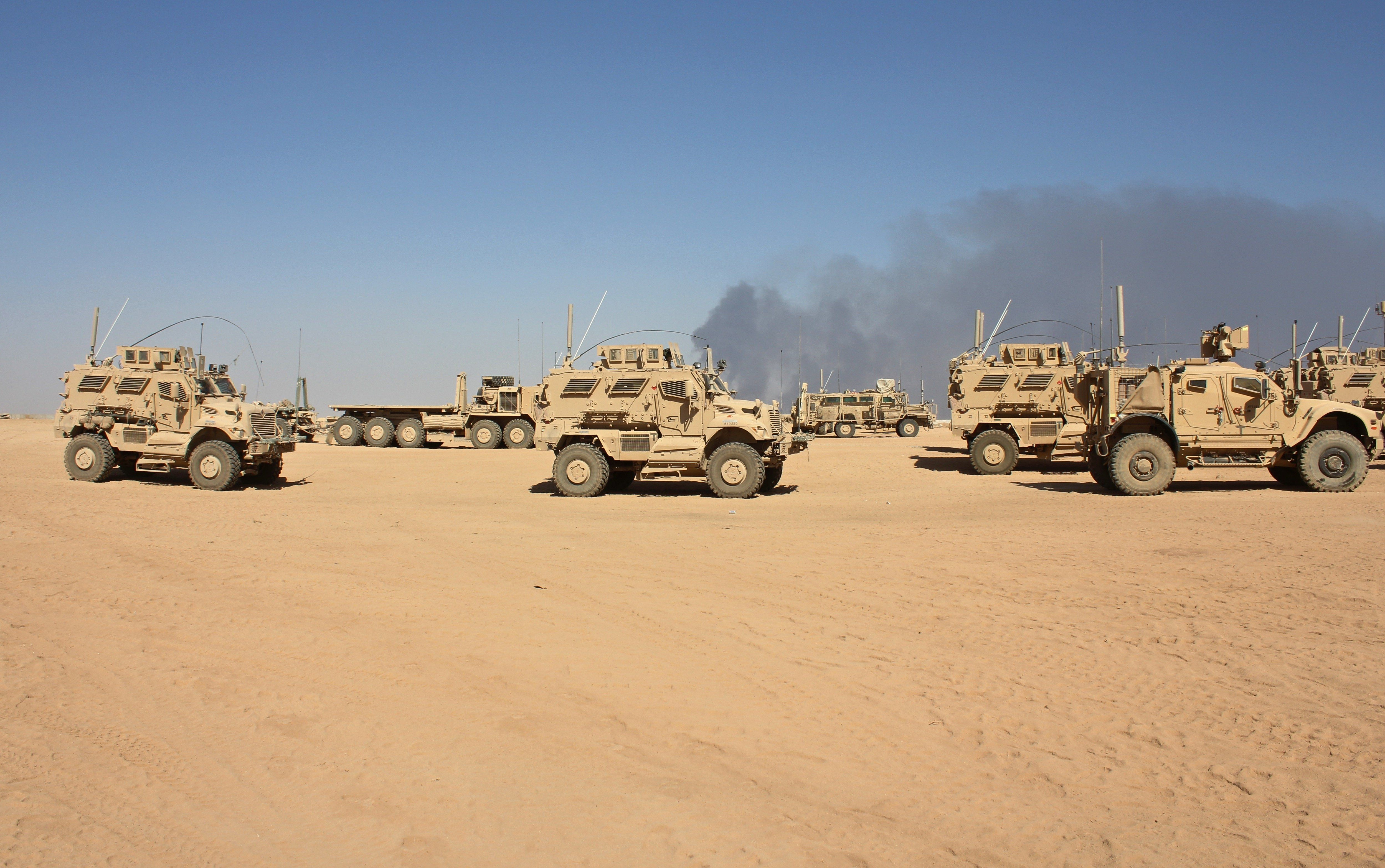 Mine-resistant vehicles basedat Qayyarah Airfield West, which will bea key staging area for...