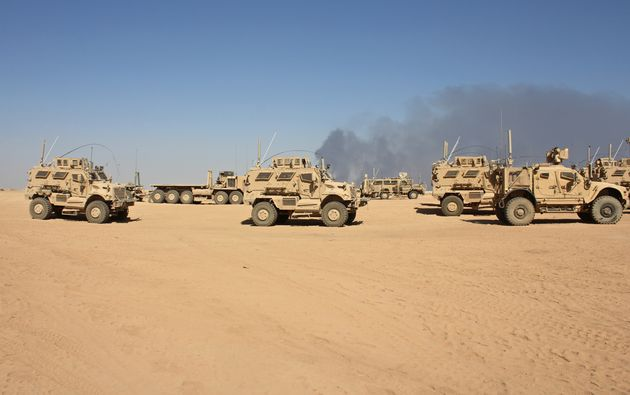 Mine-resistant vehicles based at Qayyarah Airfield West, which will be a key staging area for...