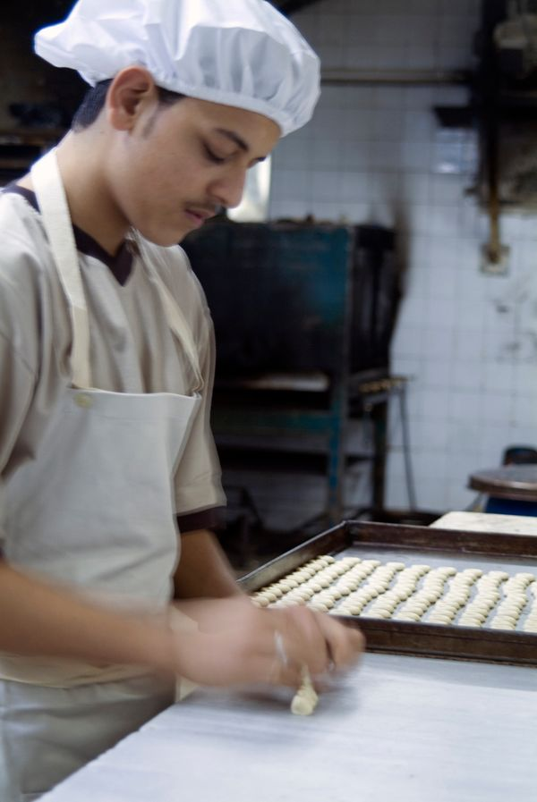 A cook at Al-Andalos Sweets in Aleppo preparing baklava in 2010.