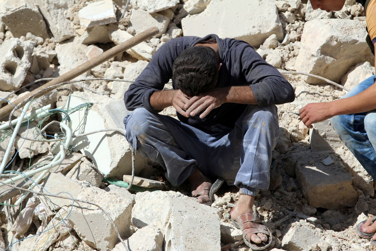 A man in Aleppo weeps after losing relatives in an airstrike on Oct. 11, 2016.