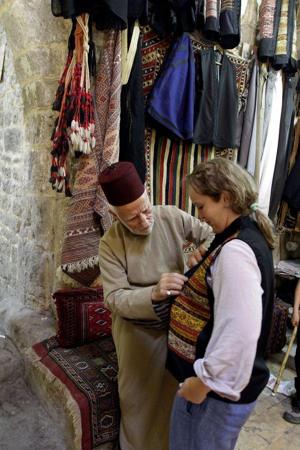 Antique dealer Musafi Assal attends to a customer in Aleppo on June 23, 2010.