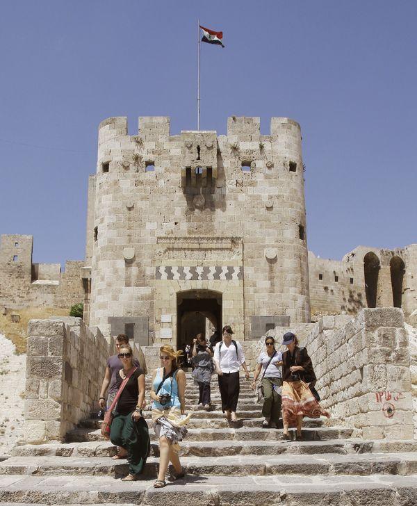 Tourists atthe entrance of Aleppo's citadel onJune 23, 2010.