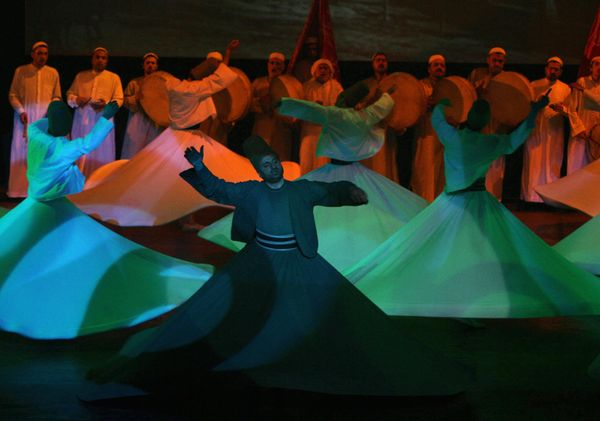 Syrian dancers perform the the Sufi tannoura dance (also known as the al-darawish or dervish dance) during the ceremony marki
