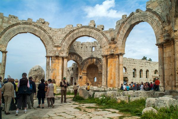 Tourists visitthe ruins at the Church of Saint Simeon Stylites on March 25, 2010.