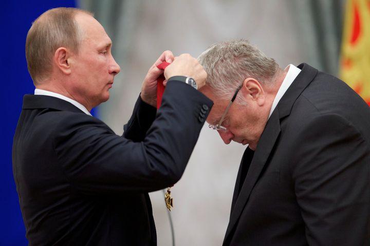 Russian President Vladimir Putin (L) awards head of the Liberal Democratic Party of Russia (LDPR) Vladimir Zhirinovsky.