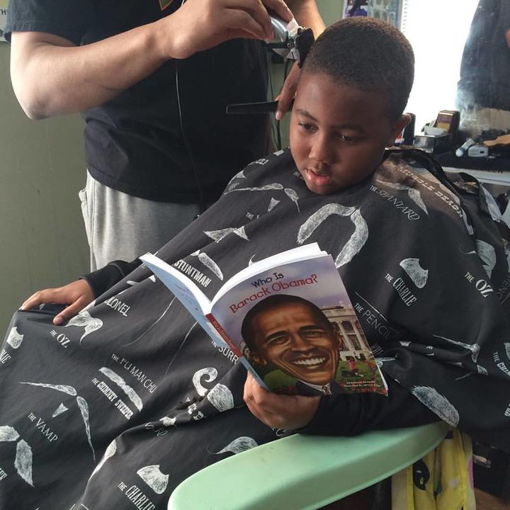 A boy reading about President Obama.