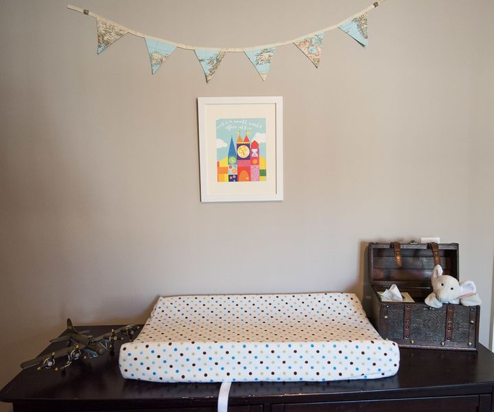 We livened up the changing table with our Snuggin peaking out from a box and map bunting from LinenandLaceHandmade on Etsy.