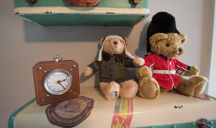 These vintage-reproduction shelves from PB Teen are a focal point of the nursery and provide a fun space for decorations like this Boeing 100th Anniversary Teddy Bear from Steiff USA and this Guardsman Teddy from British Teddies.