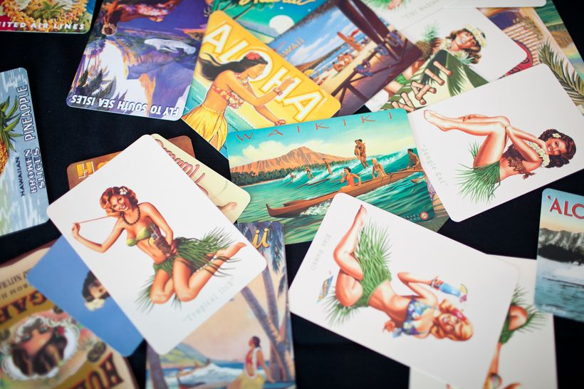 Vintage postcards are a fun way to get guests to participate in a guest book at a travel-inspired wedding.