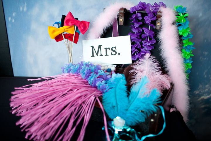 Our photo booth props included Hawaiian leis, hula skirts, cowboy hats, boas, bow ties and more and were displayed in a vintage reproduction suitcase I found at Marshall's.