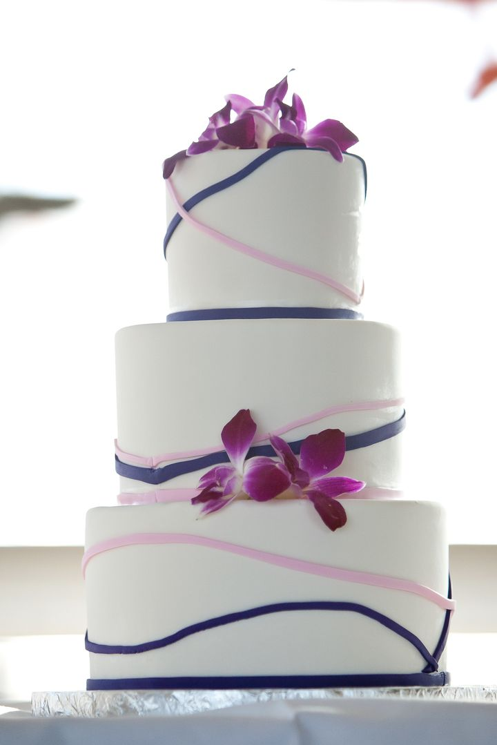 We added purple orchids to the cake for the tropical travel element.