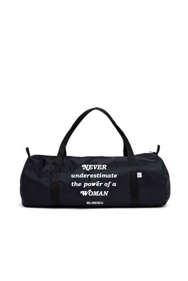 """$39 at <a href=""""https://www.millioneiress.com/collections/accessories/products/never-underestimate-the-power-of-a-woman-gym-b"""