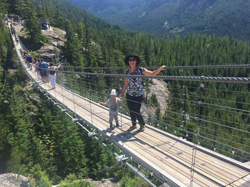 Walking across the bridge at the summit of the Sea to Sky Gondola in Squamish, BC.