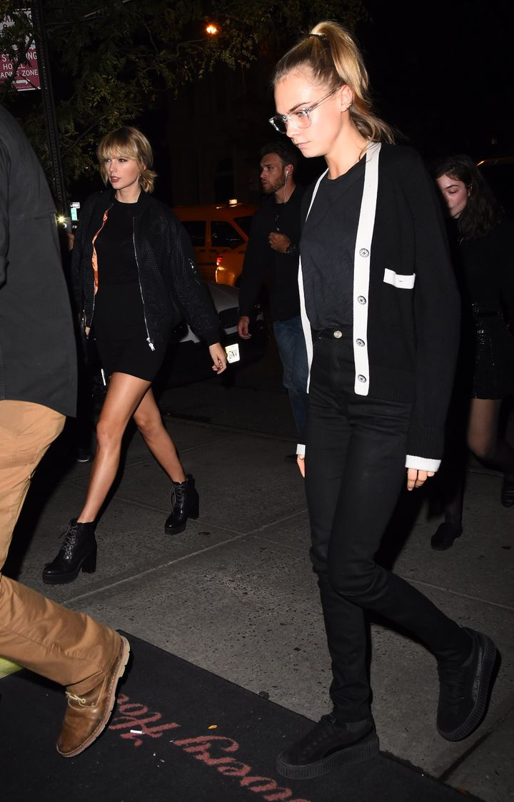 Taylor Swift and Cara Delevingne in matching get-ups.