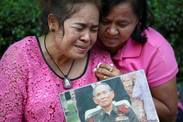 Well-wishers weep and pray for Thailand's King Bhumibol Adulyadej at the Siriraj hospital where he died.