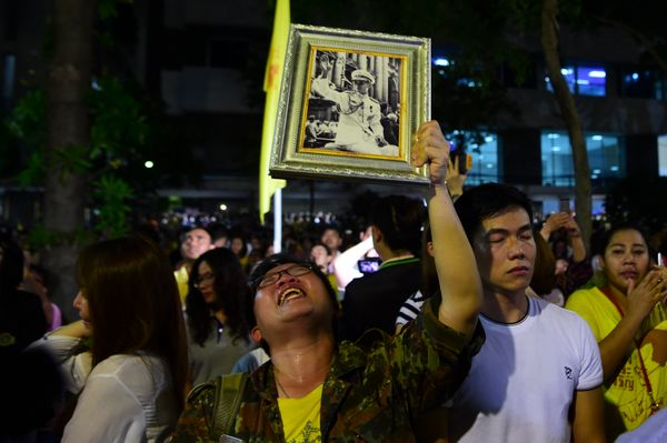 Supporter of Thailand's King Bhumibol Adulyadej react after the king passed away.