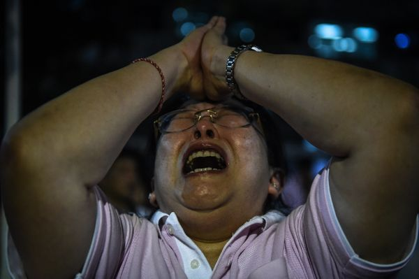 A distraught woman reacts to the Thai king's death.