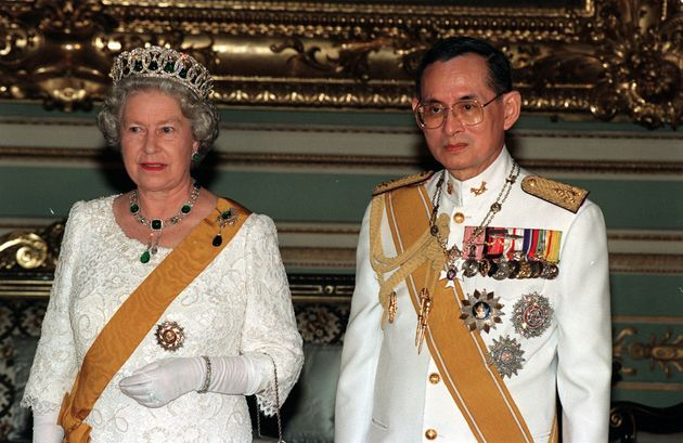 File photo dated 28/10/96 of Queen Elizabeth II and King Bhumibol Adulyadej of Thailand at a state banquet...