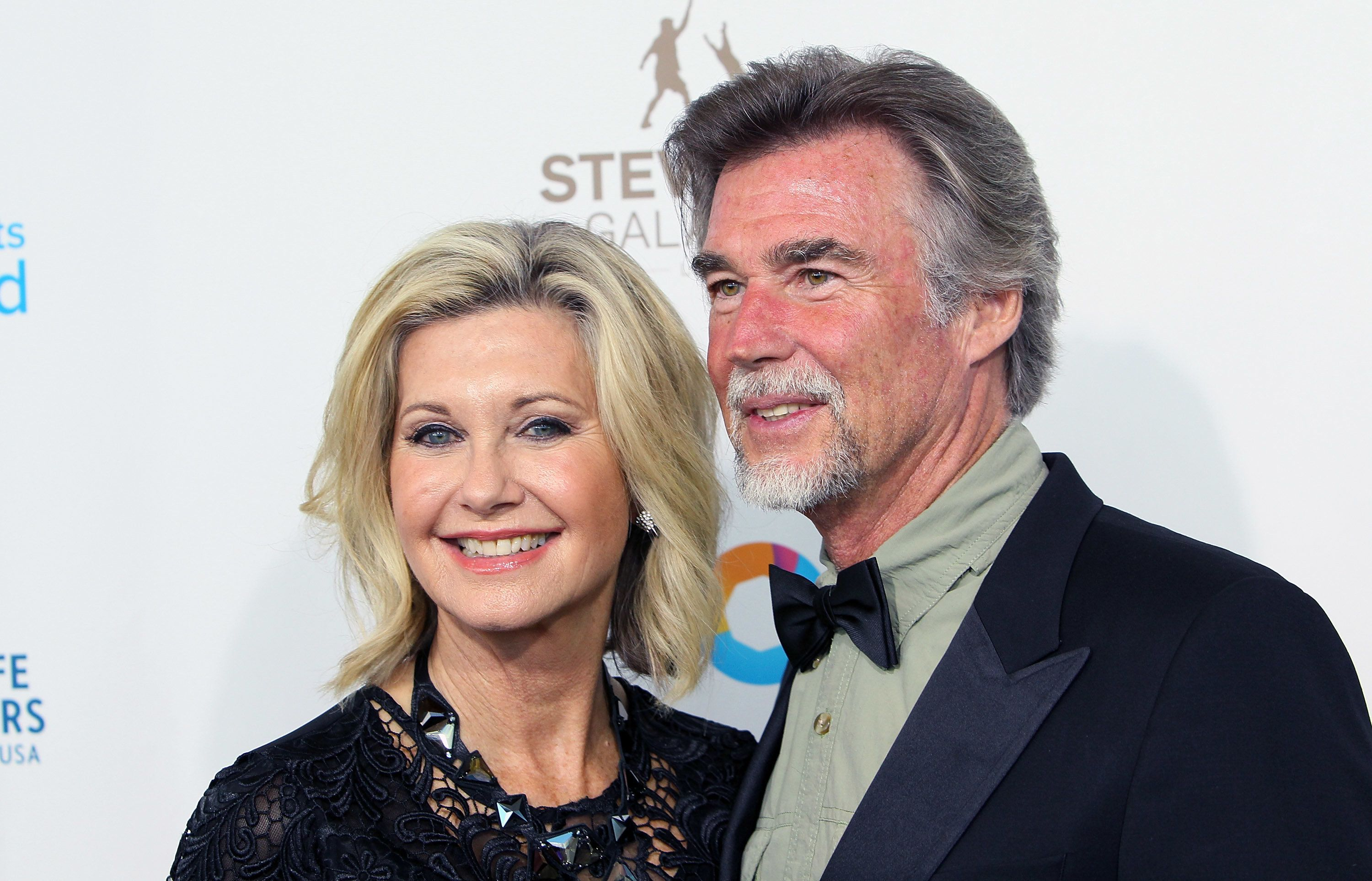 LOS ANGELES, CA - MAY 21:  Singer Olivia Newton-John (L) and husband John Easterling attend the Steve Irwin Gala Dinner at JW Marriott Los Angeles at L.A. LIVE on May 21, 2016 in Los Angeles, California.  (Photo by David Livingston/Getty Images)