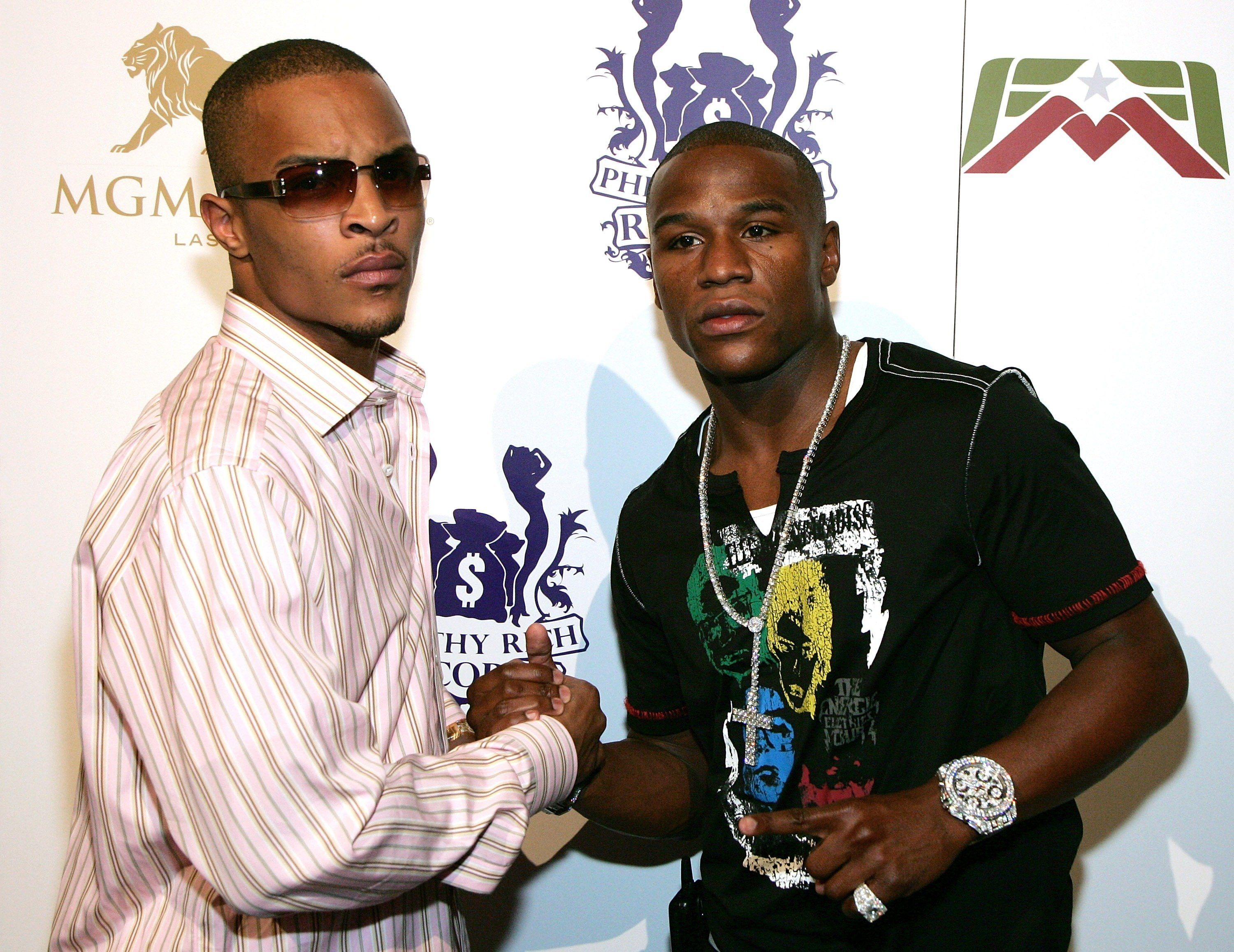 LAS VEGAS - JULY 29:  Rapper T.I. (L) and boxer Floyd Mayweather Jr. arrive at a party at Studio 54 inside the MGM Grand Hotel/Casino July 29, 2007 in Las Vegas, Nevada.   (Photo by Ethan Miller/Getty Images for MGM)