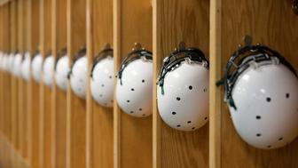Helmets hanging in locker room