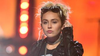 LAS VEGAS, NV - SEPTEMBER 23:  Entertainer Miley Cyrus performs during her appearance with Billy Idol at the 2016 iHeartRadio Music Festival at T-Mobile Arena on September 23, 2016 in Las Vegas, Nevada.  (Photo by Ethan Miller/WireImage)