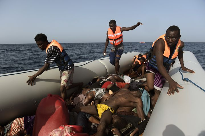 Migrants step over dead bodies while being rescued by members of Proactiva Open Arms nongovernmental organization in the