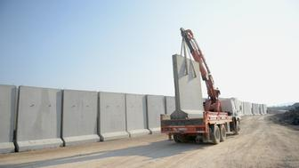 GAZIANTEP, TURKEY - DECEMBER 31: 9 tones weighted wall under construction is seen along the border with Syria in Gaziantep, Turkey on December 31, 2015 to take action against illegal crossings. (Photo by Ensar Ozdemir/Anadolu Agency/Getty Images)