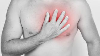 Man having an ache in his chest on white background