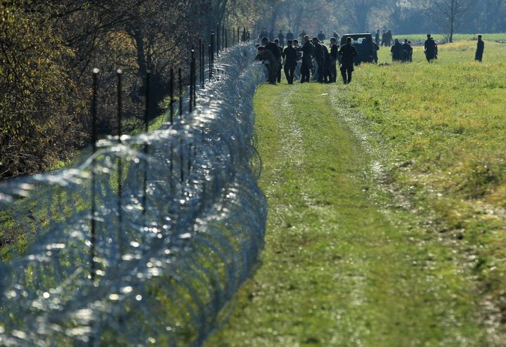 Slovenian soldiers work on a wire fence in the village of Veliki Obrez on Nov. 11, 2015.