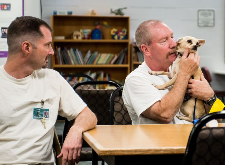 Inmates David Craig (L) and Douglas Gallagher reunite with Skeeter.